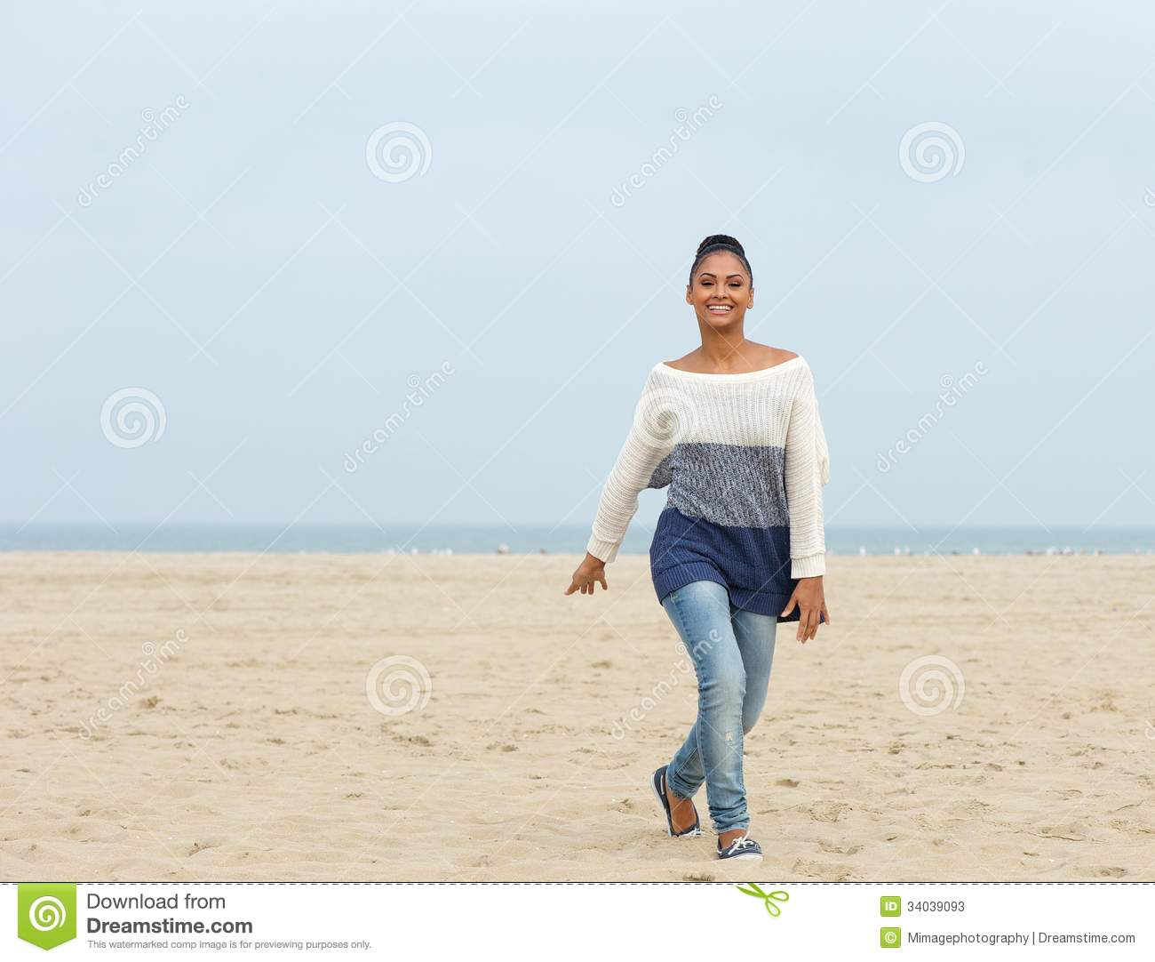 Cheerful Young Woman Walking On A Beach Stock Photos ...
