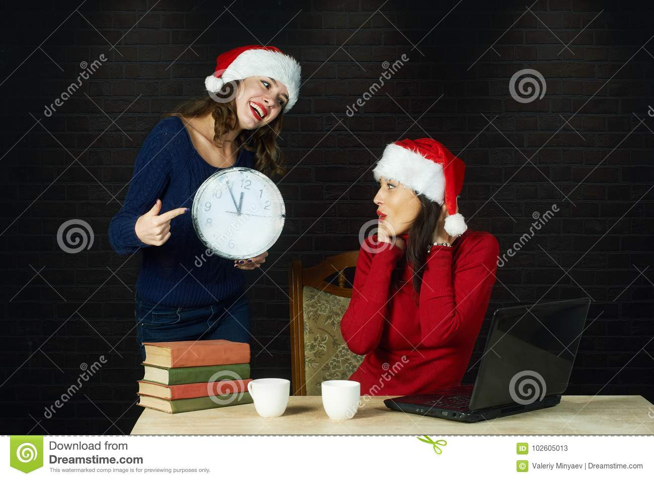 Cheerful young woman in Santa`s hats .