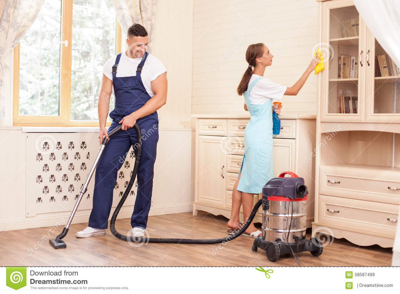 Cleaning The House cheerful young workers are cleaning the house with stock photo