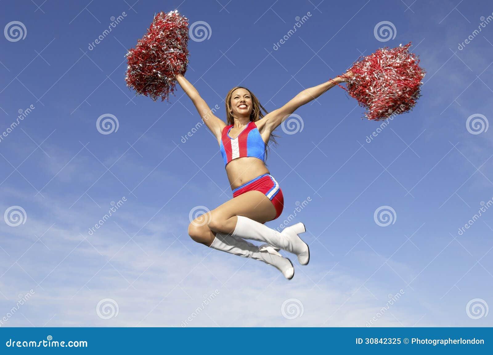 Cheerleader Jumping Midair With Pom Poms