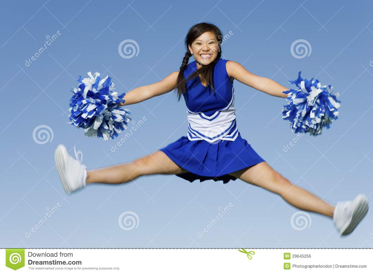 cheerleader jumping with pom poms stock photo image of ecstatic beauty 29645256. Black Bedroom Furniture Sets. Home Design Ideas