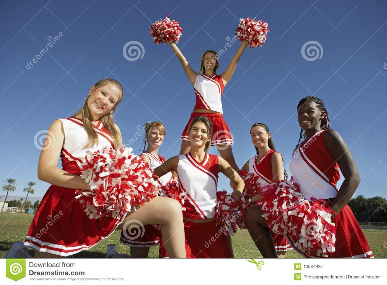 Cheerleading squad in formation on field