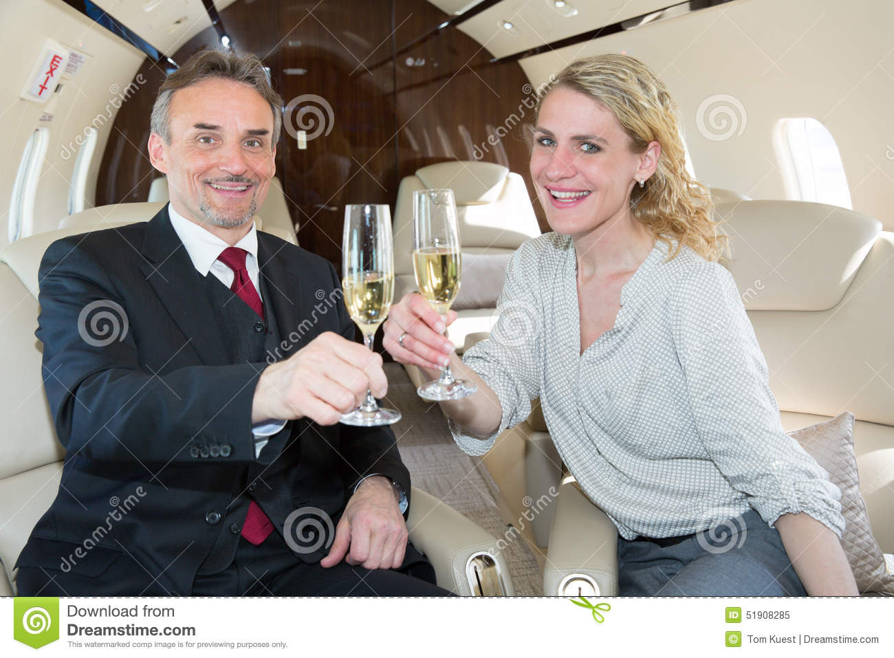 cheers clink glasses business team in a corporate jet drinking c stock photo image 51908285. Black Bedroom Furniture Sets. Home Design Ideas