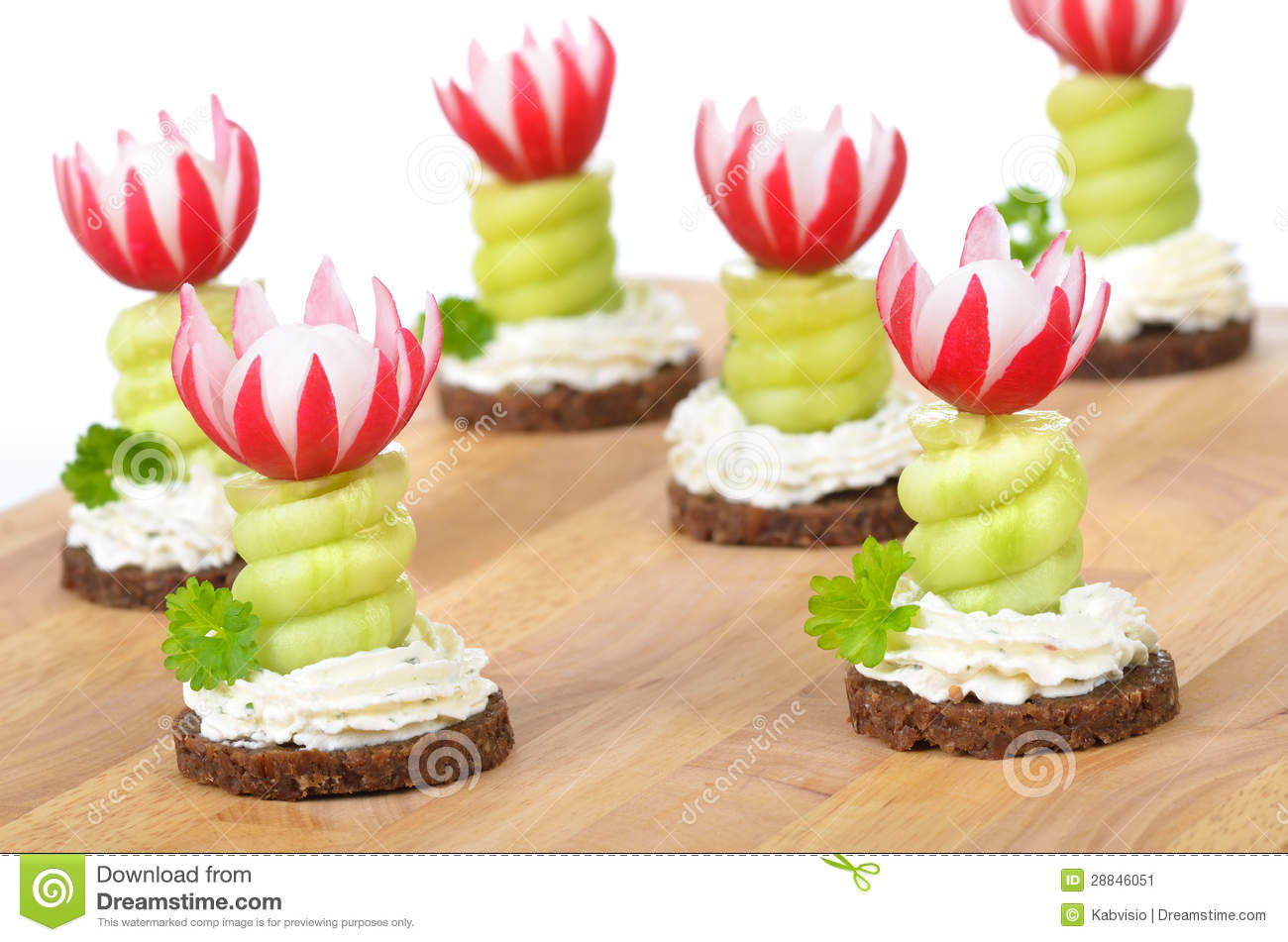 Decorated cheese appetizers: Spiced cream cheese with spiral cucumber ...