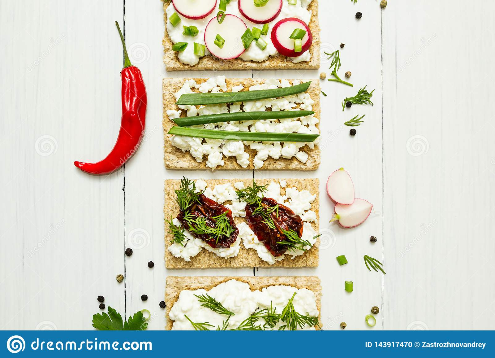 Cheese appetizers with vegetables on a white wooden background. View from above. Healthy eating