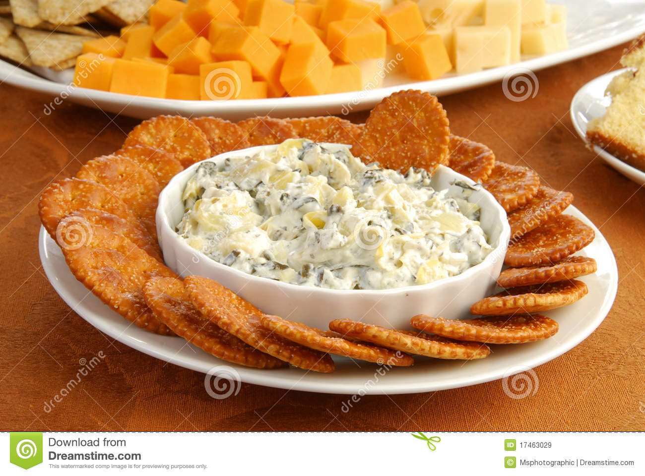 Parmesan cheese dip with spinach and artichokes.