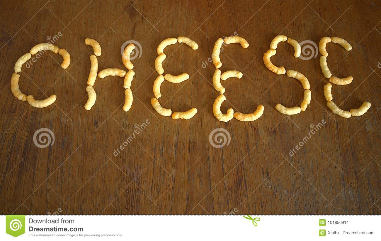 Cheese Doodles On Brown Oak Table Stock Photo Image Of Writing