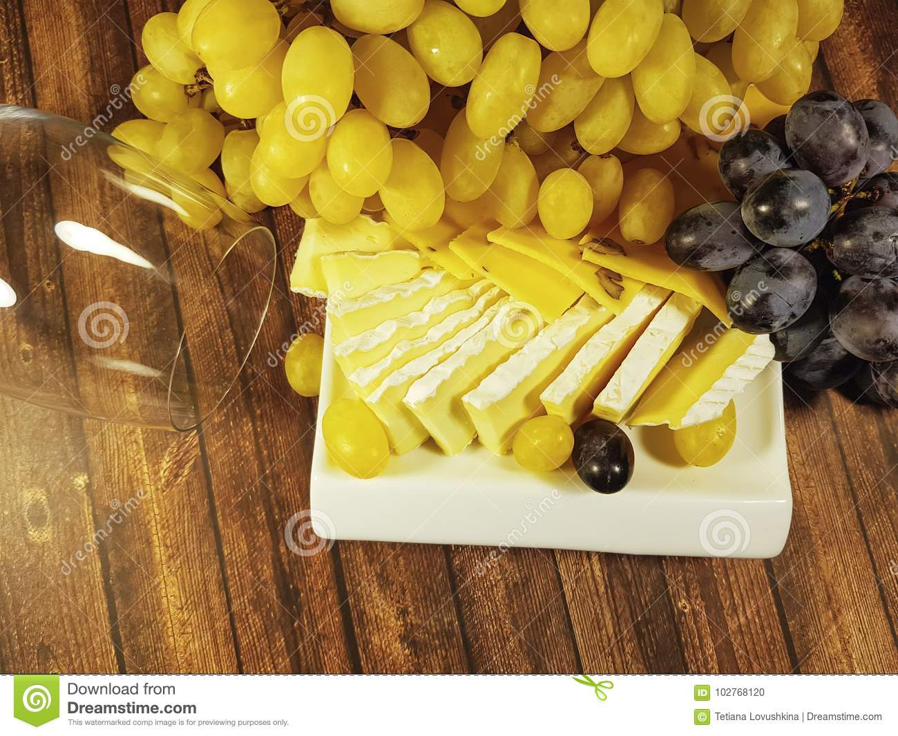 Cheese grapes still life wooden background glass beverage