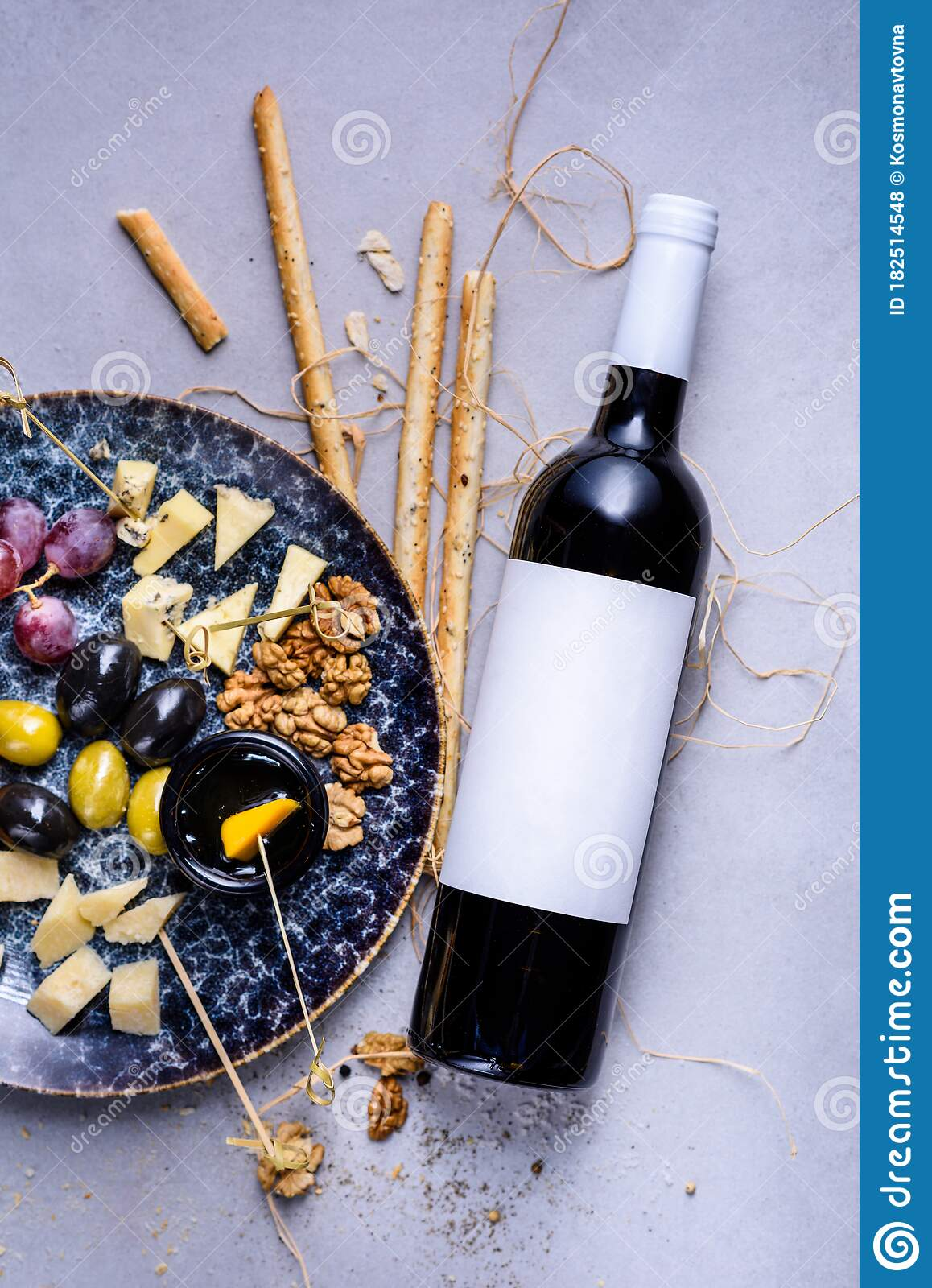 Cheese Plate With Grapes And Olives Snacks And Cheese Served With Bottle Of Wine Top View Copy Space Stock Photo Image Of Ingredient Flat 182514548