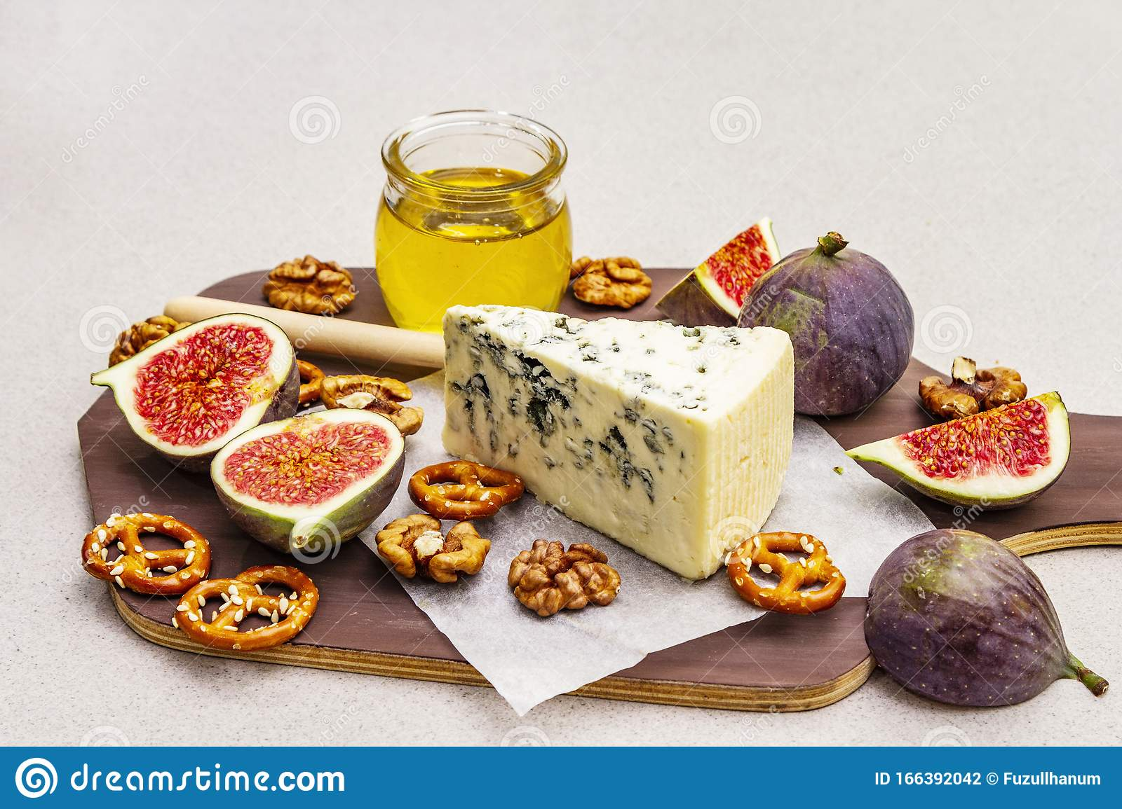 Cheese Platter Board With Blue Cheese Honey Walnuts Figs Pretzels Stock Photo Image Of Dish Board 166392042