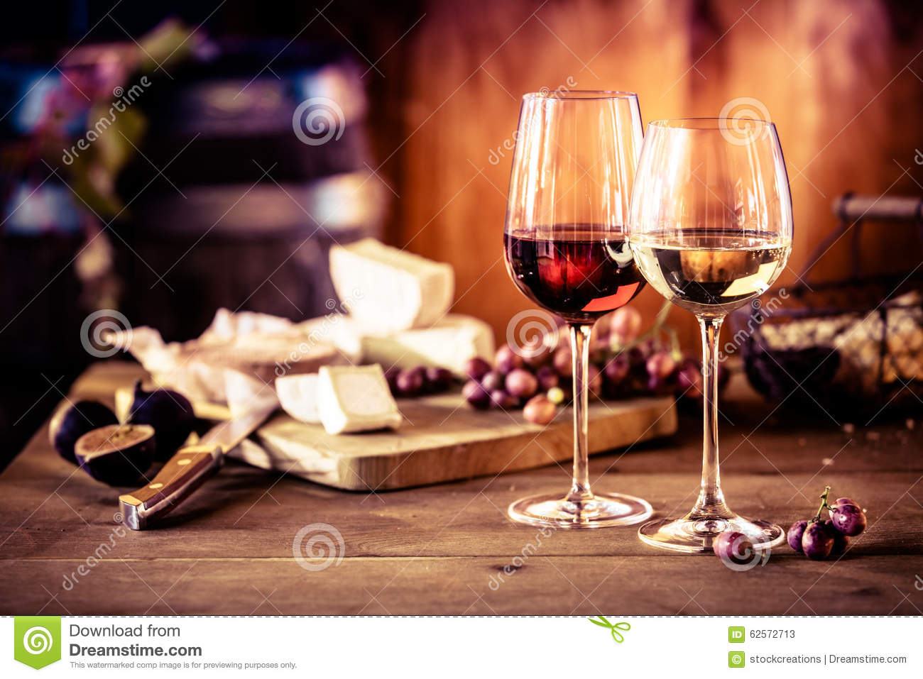 Cheese platter with wine in front of fire