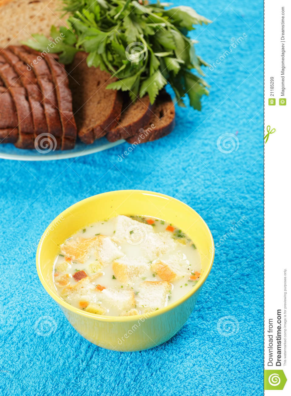 Cheese soup and bread with greens