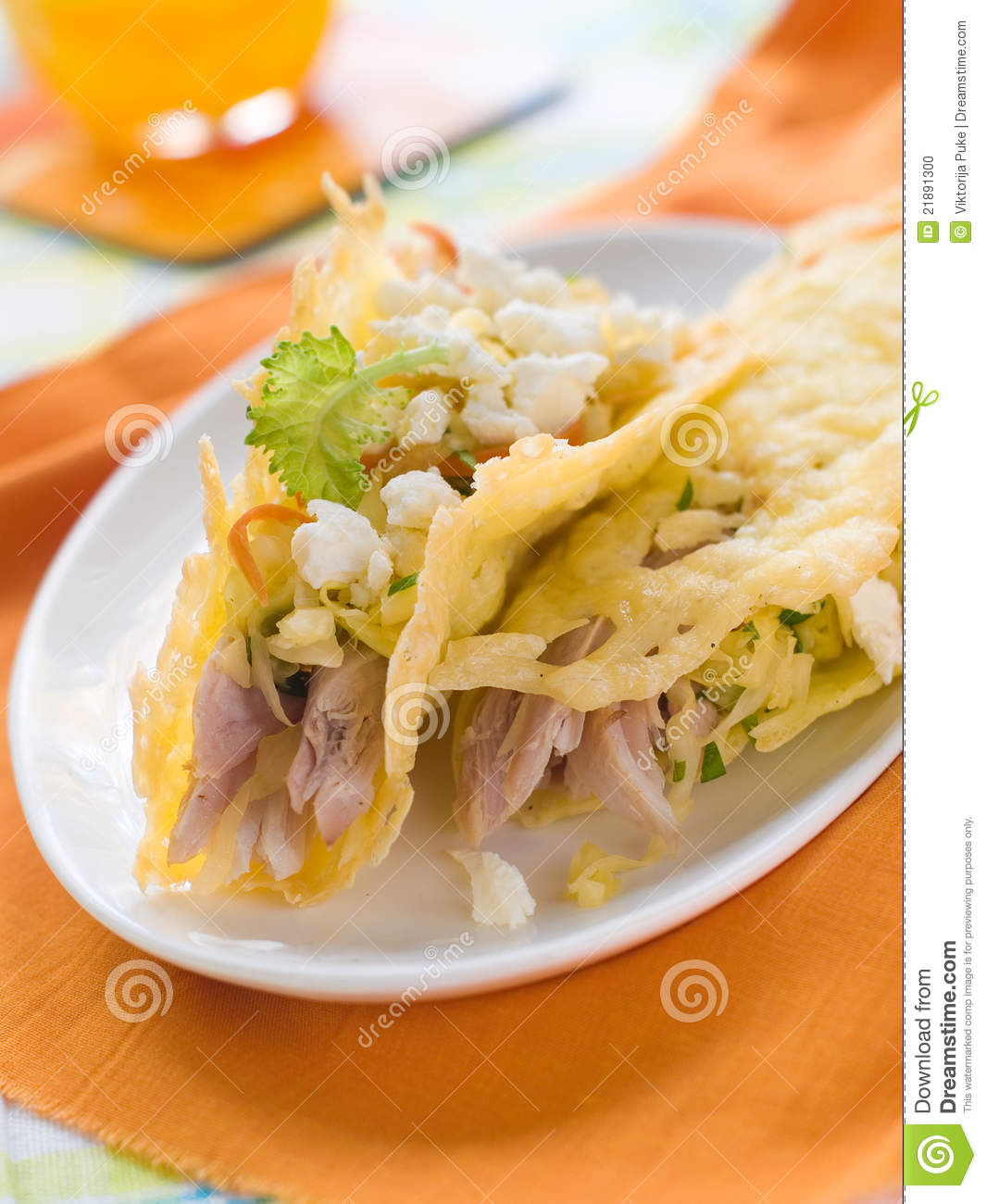 Cheese tacos with chicken and cabbage salad. Selective focus.
