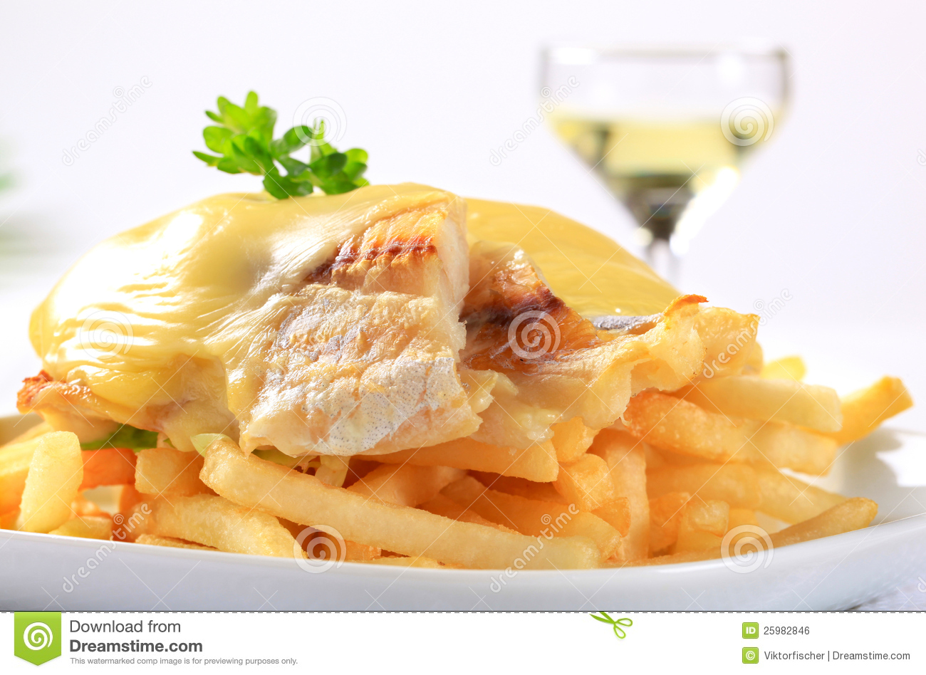 Cheese topped fish fillets with french fries stock photo for Fish and cheese