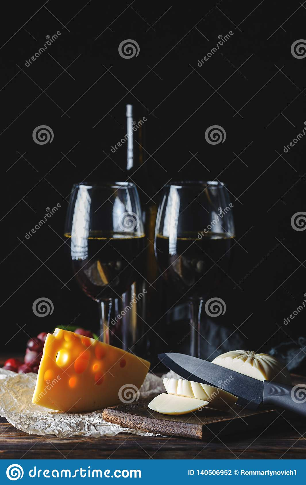 Cheese wine and a corkscrew on a wooden table