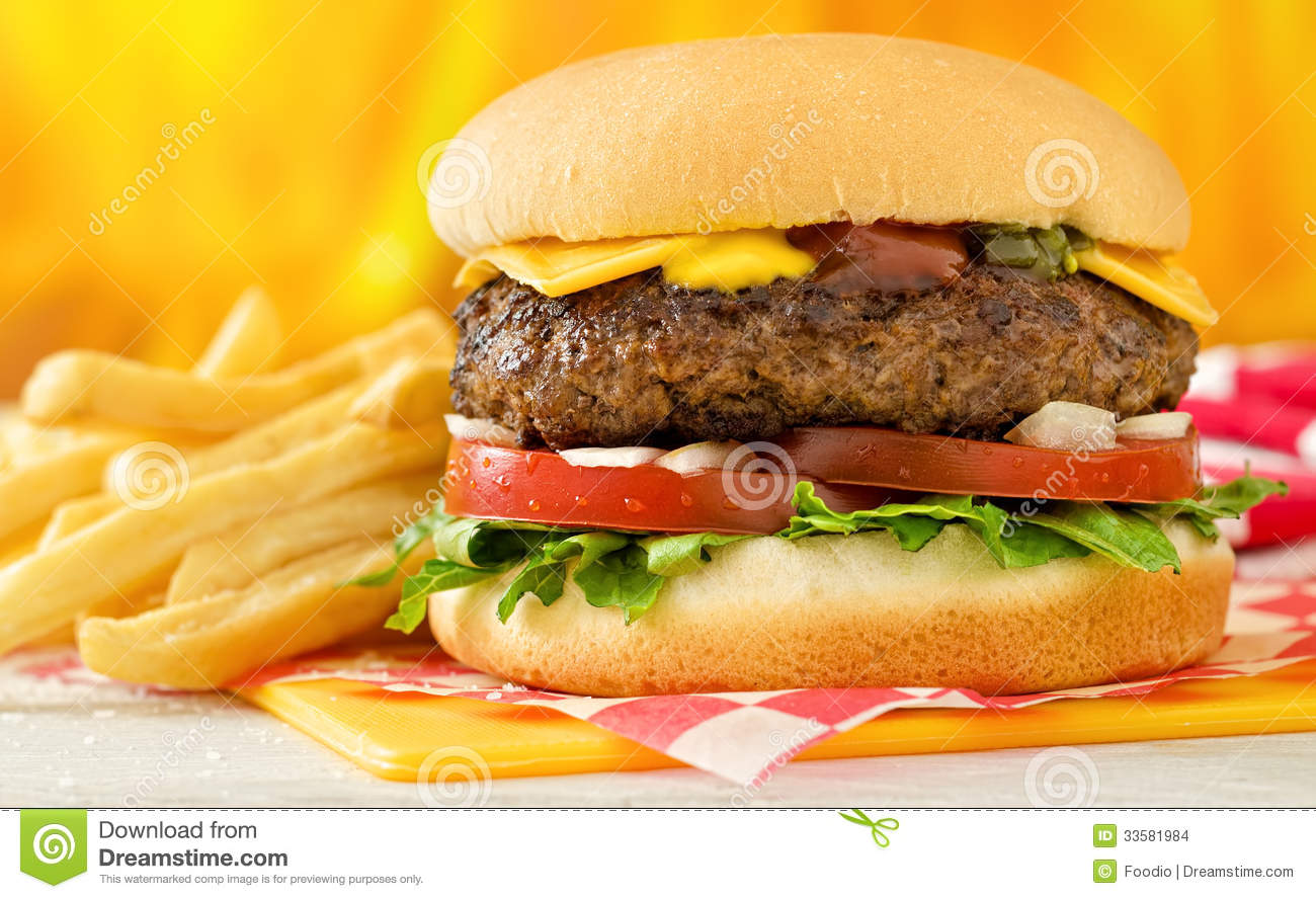 classic style cheeseburger with beef, cheese, lettuce, tomatoe ...