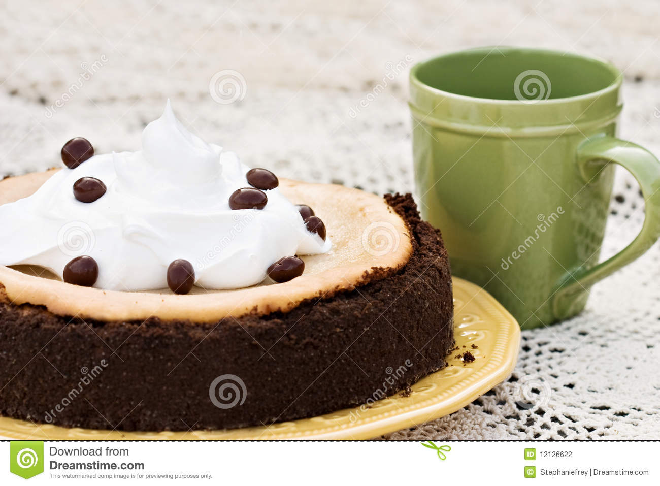 Cheesecake garnished with chocolate covered coffee bean with shallow ...