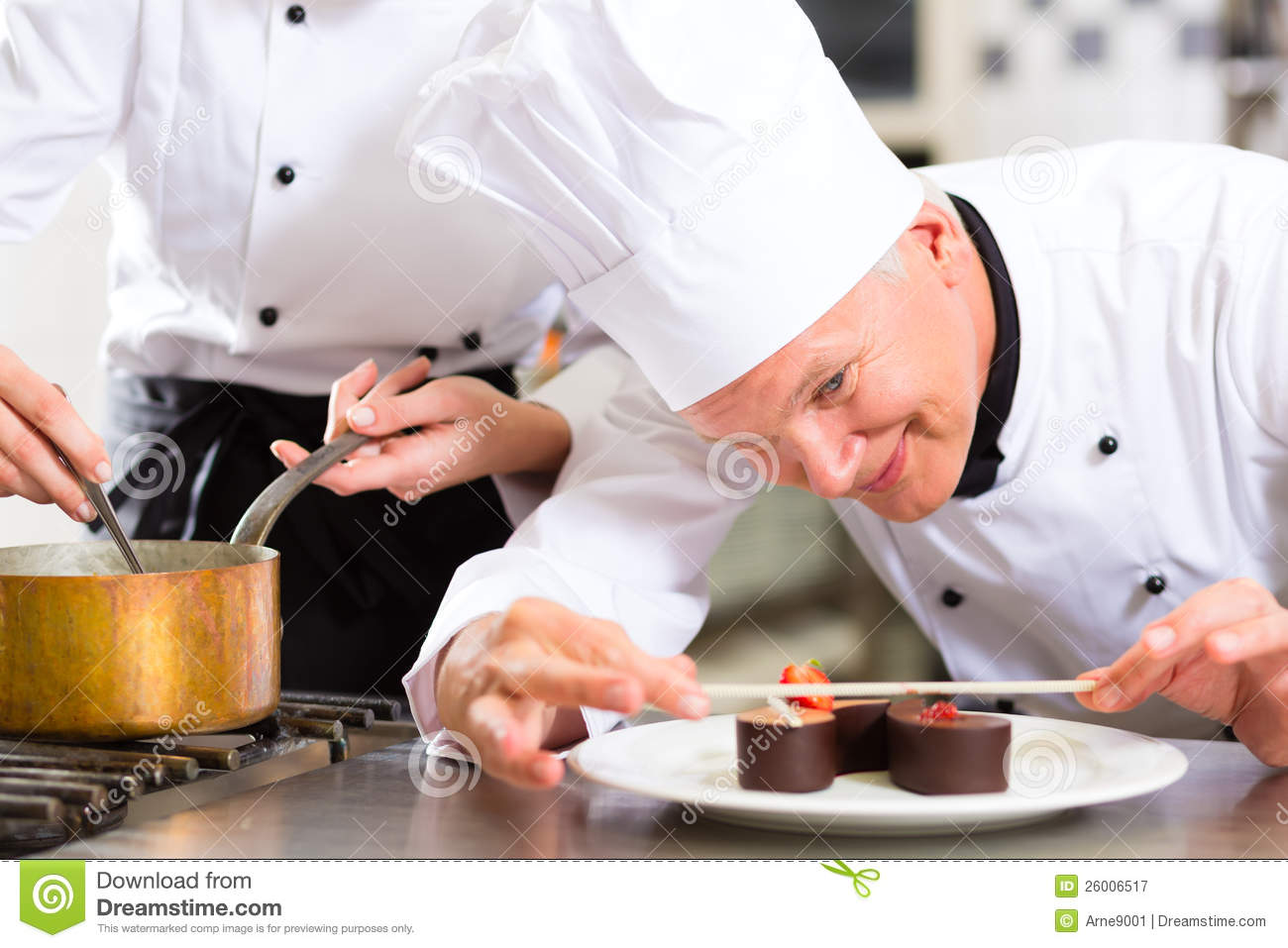 cook the pastry chef in hotel or restaurant kitchen cooking he is