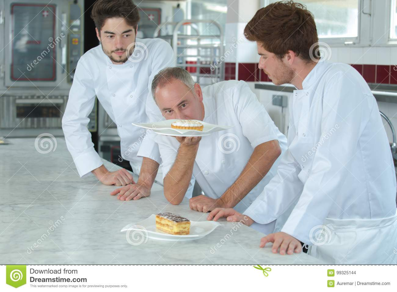 Chef checking assistants cakes