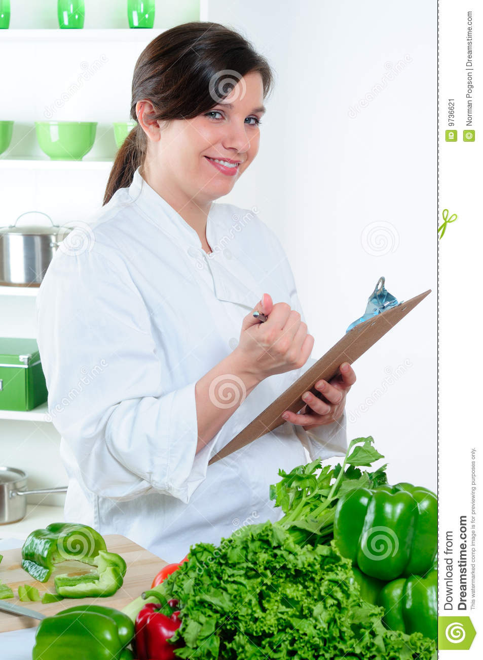 female chef in her kitchen checking the food for her menu