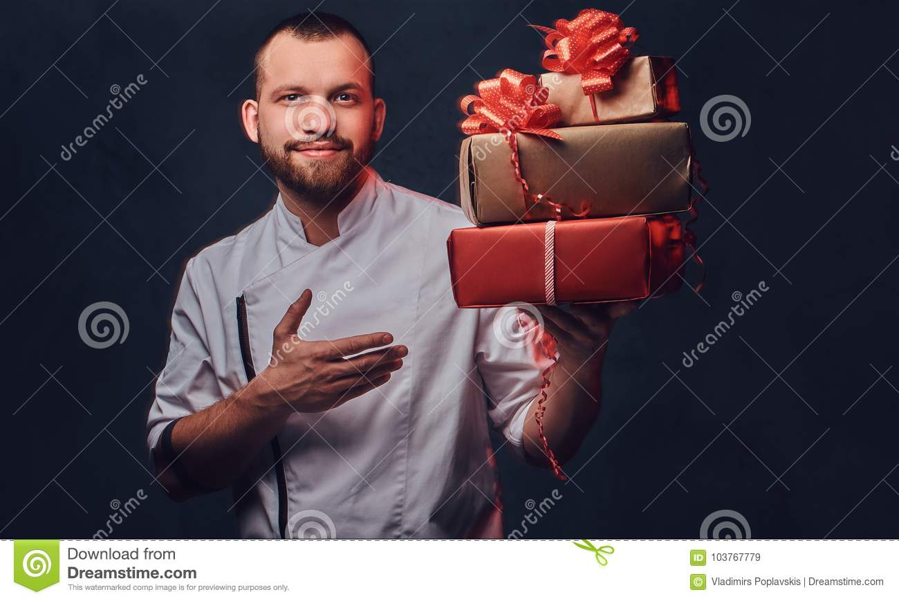 Chef Cook Holds Colorful Paper Christmas Gifts. Stock Image - Image ...