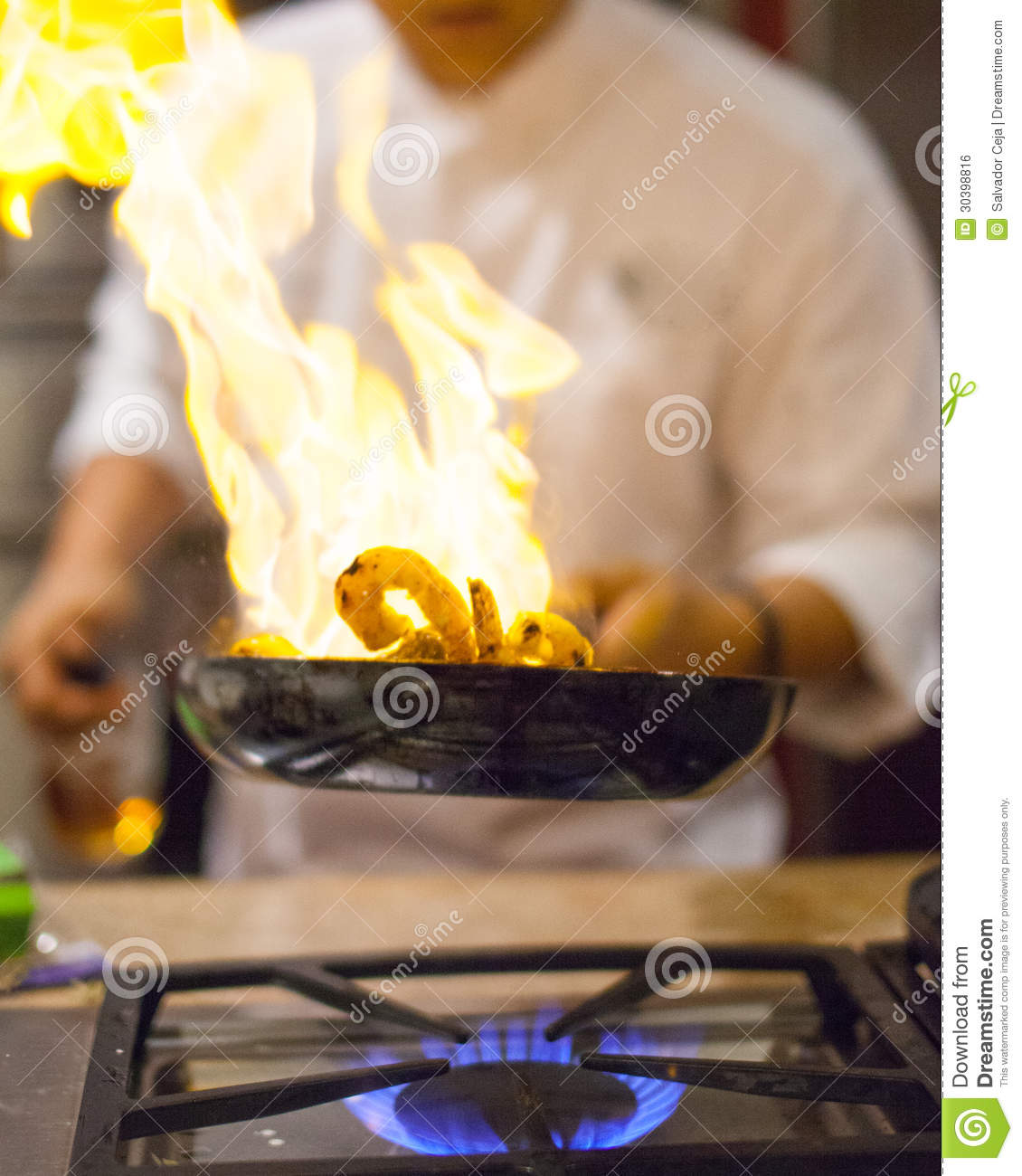 Blue Flame Kitchen: Chef Cooking Royalty Free Stock Image