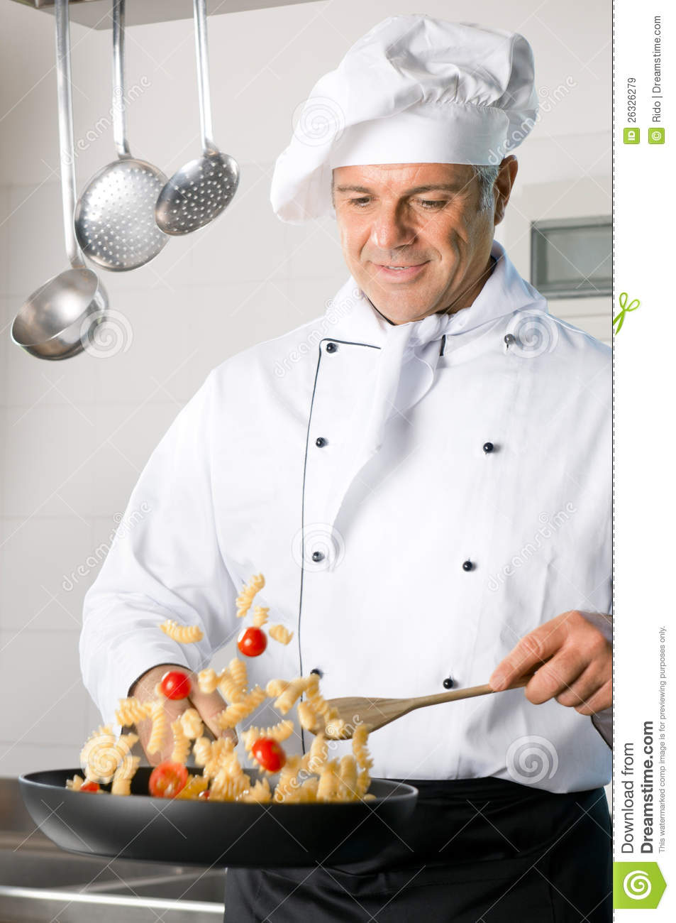 Happy mature chef stir-fry Italian pasta on a cooking pan at ...