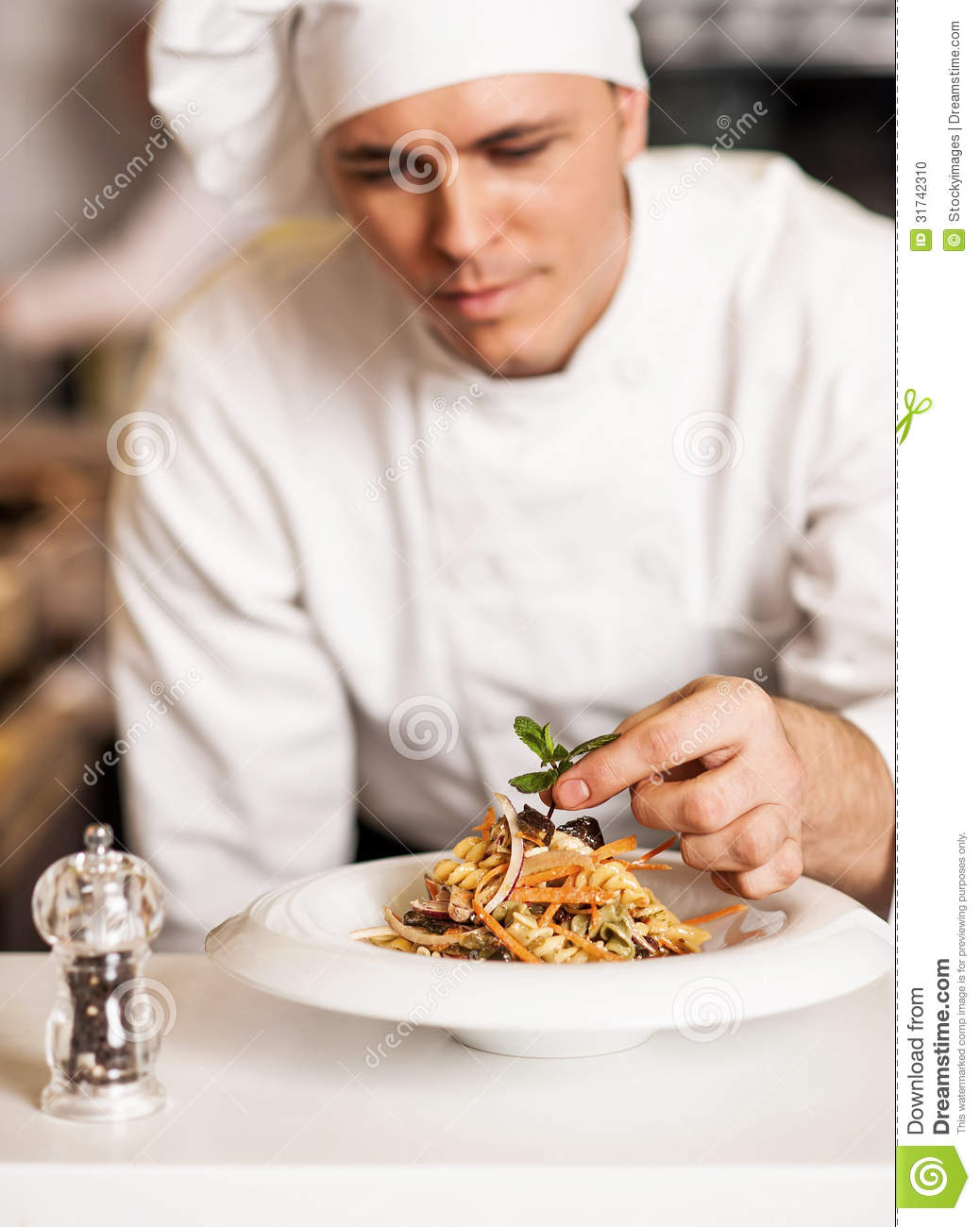 Chef Decorating Pasta Salad With Herbal Leaves Stock Photo - Image ...
