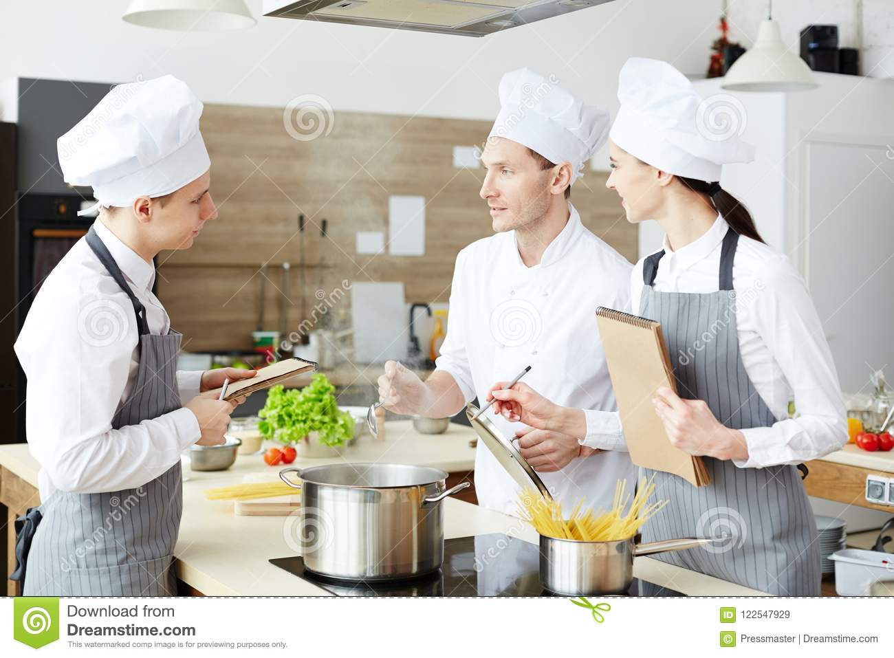 Chef Explaining Cooking Techniques Stock Image - Image of note ...