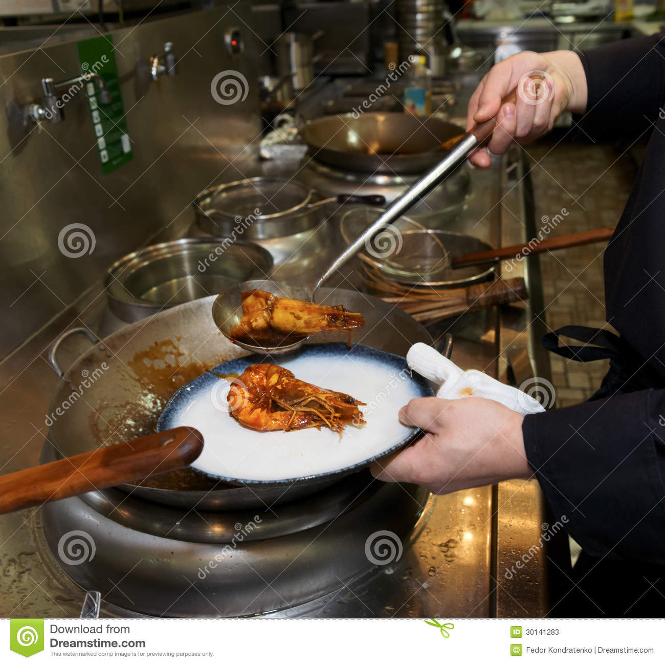 Chef Is Frying Prawns In Wok Stock Photos
