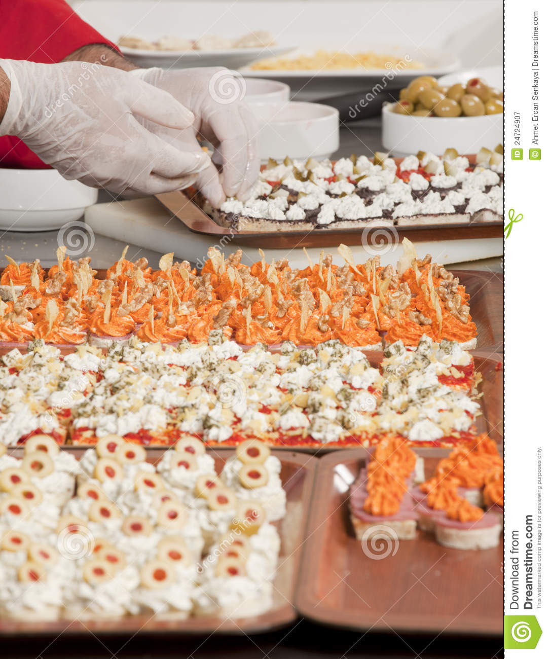 Chef garnishing canapes for party royalty free stock for Canape garnishes
