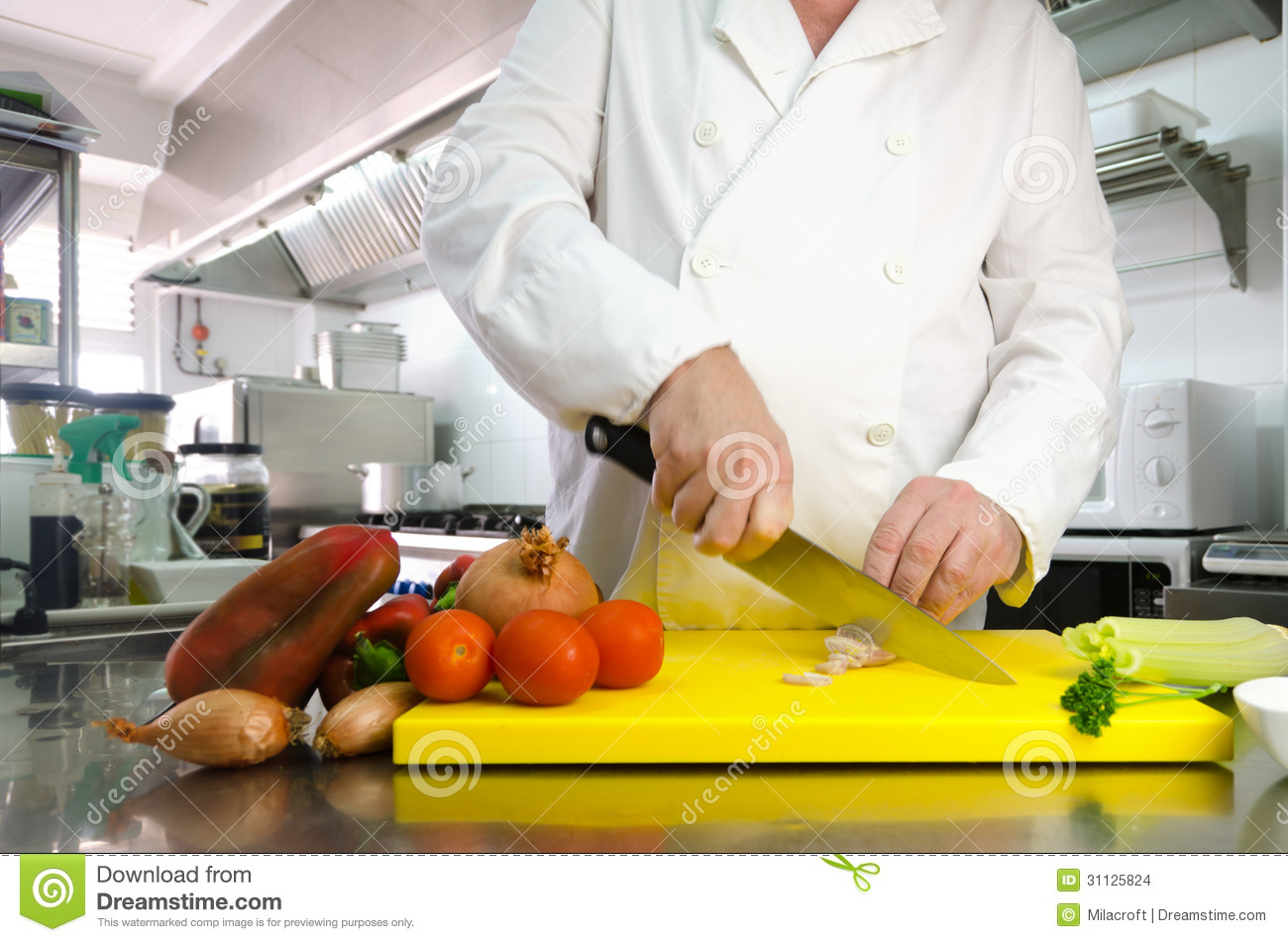 Restaurant Kitchen Background Chef Preparing Onion In Restaurant Or Hotel Kitchen Royalty Free