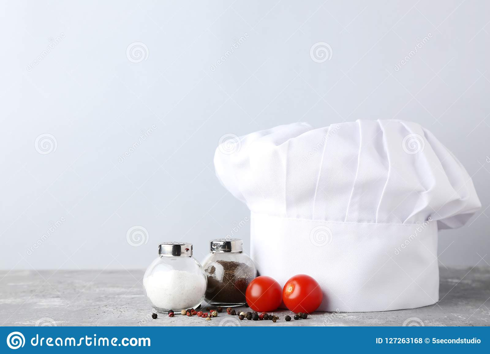 Chef hat with salt, pepper