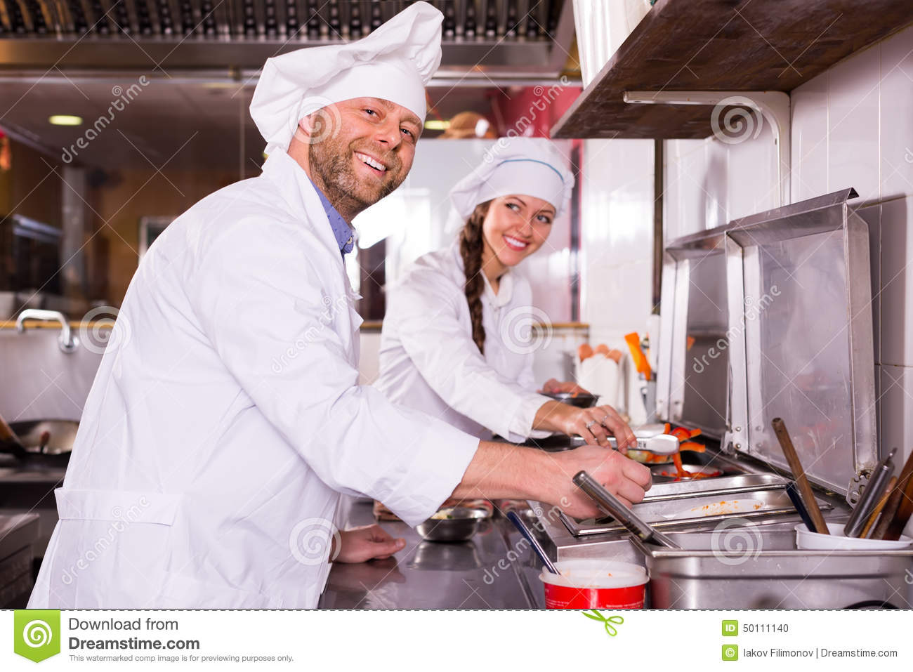 chef and his helper at bistro kitchen stock photo image 50111140