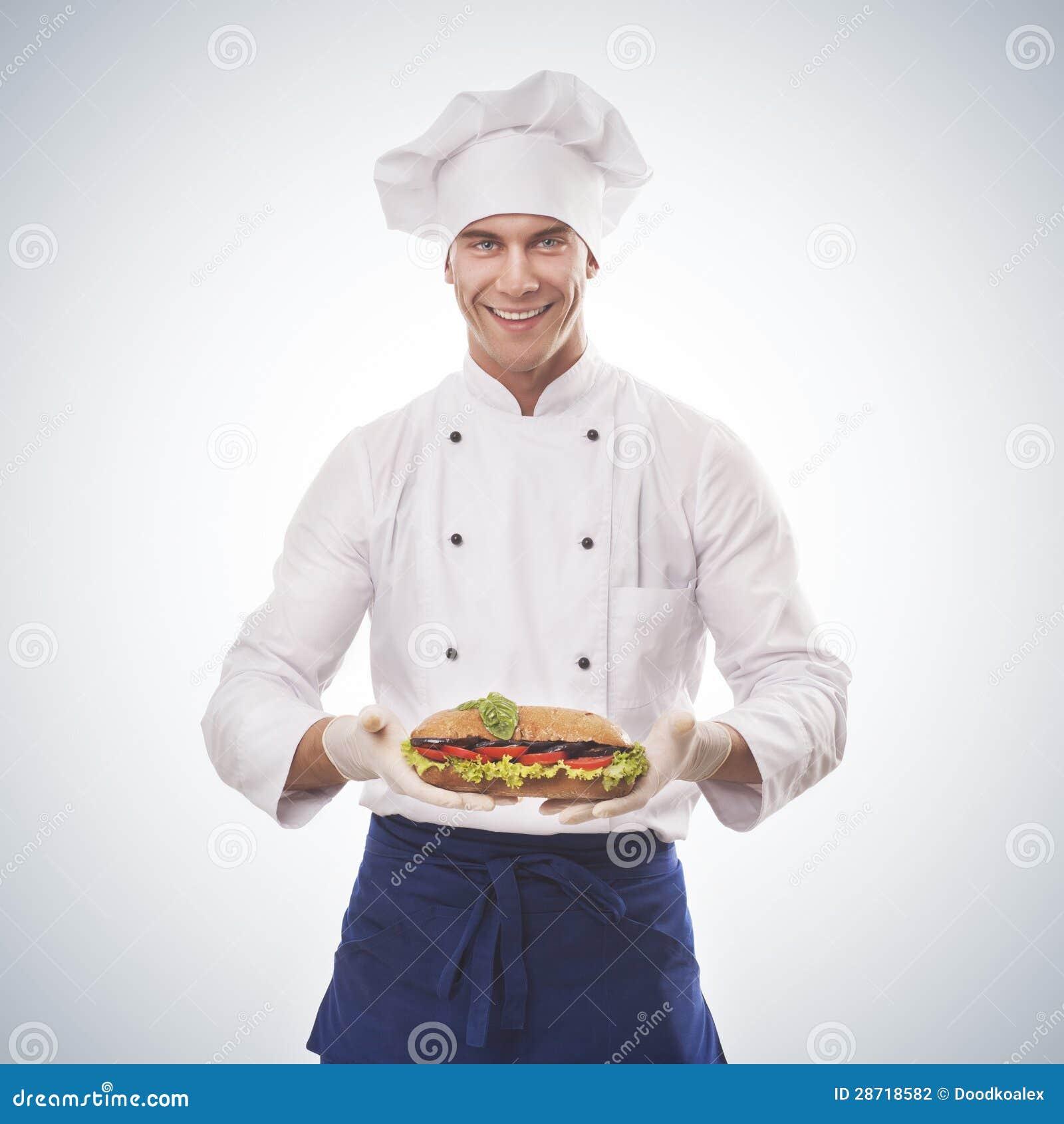 Chef holding a big sandwich
