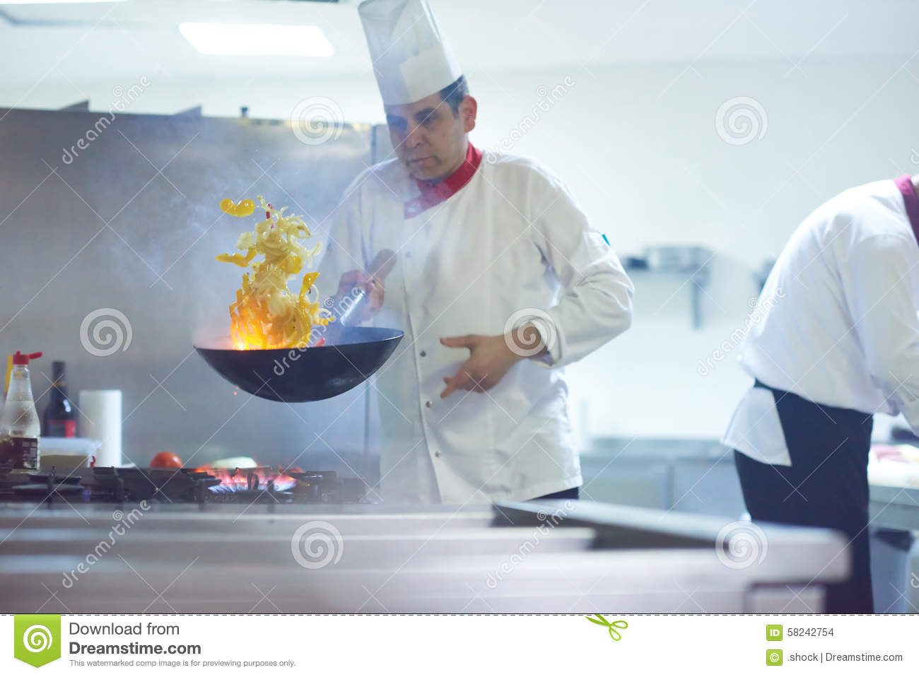 Chef In Hotel Kitchen Prepare Food With Fire Stock Photo - Image of ...