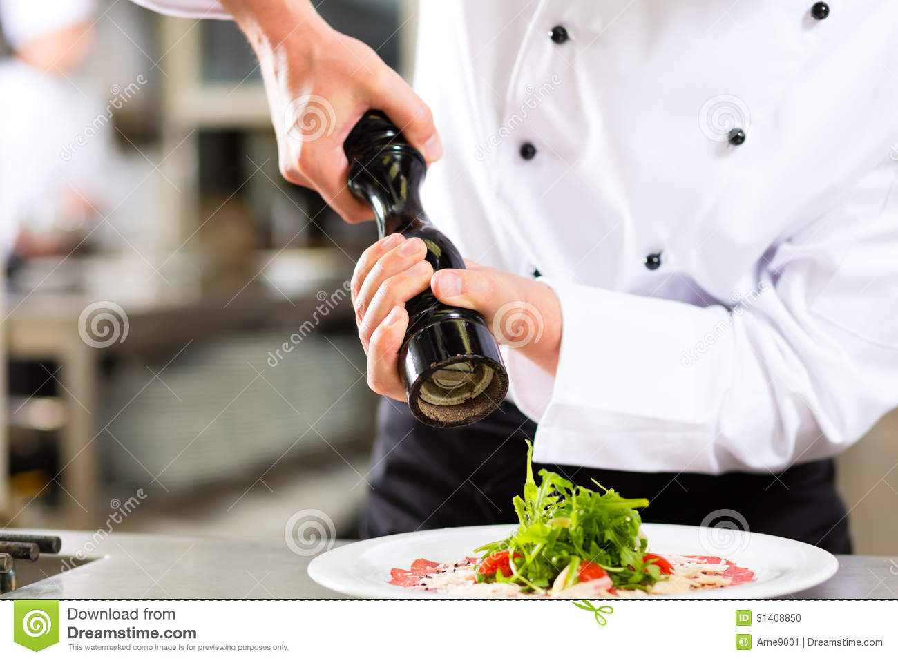 Restaurant Kitchen Hand chef in hotel or restaurant kitchen cooking stock photo - image