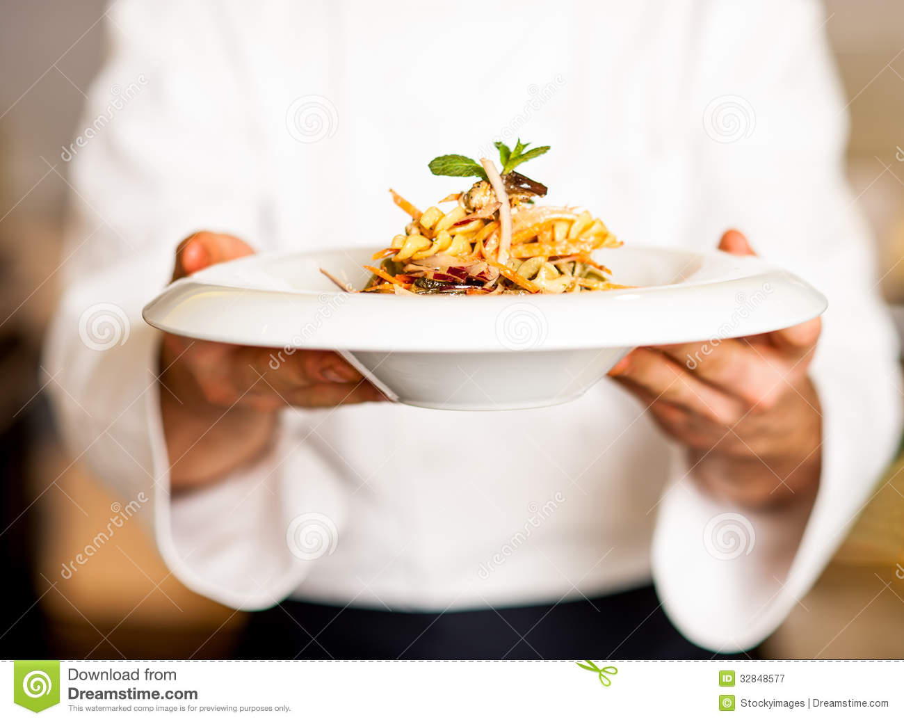 Chef offering pasta salad to you