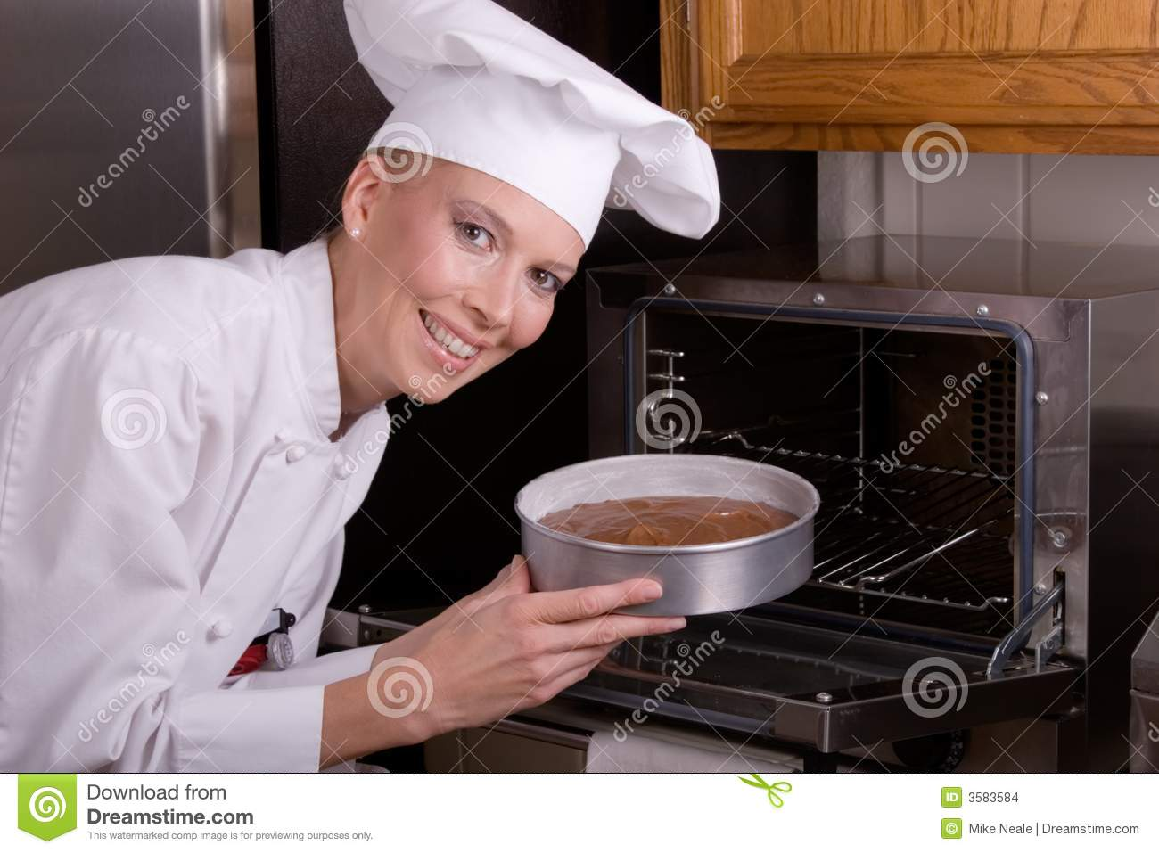 Chef Places Cake In Oven Stock Images Image 3583584
