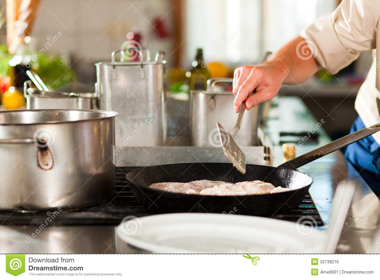 Restaurant Kitchen Chefs chef preparing fish in restaurant or hotel kitchen royalty free