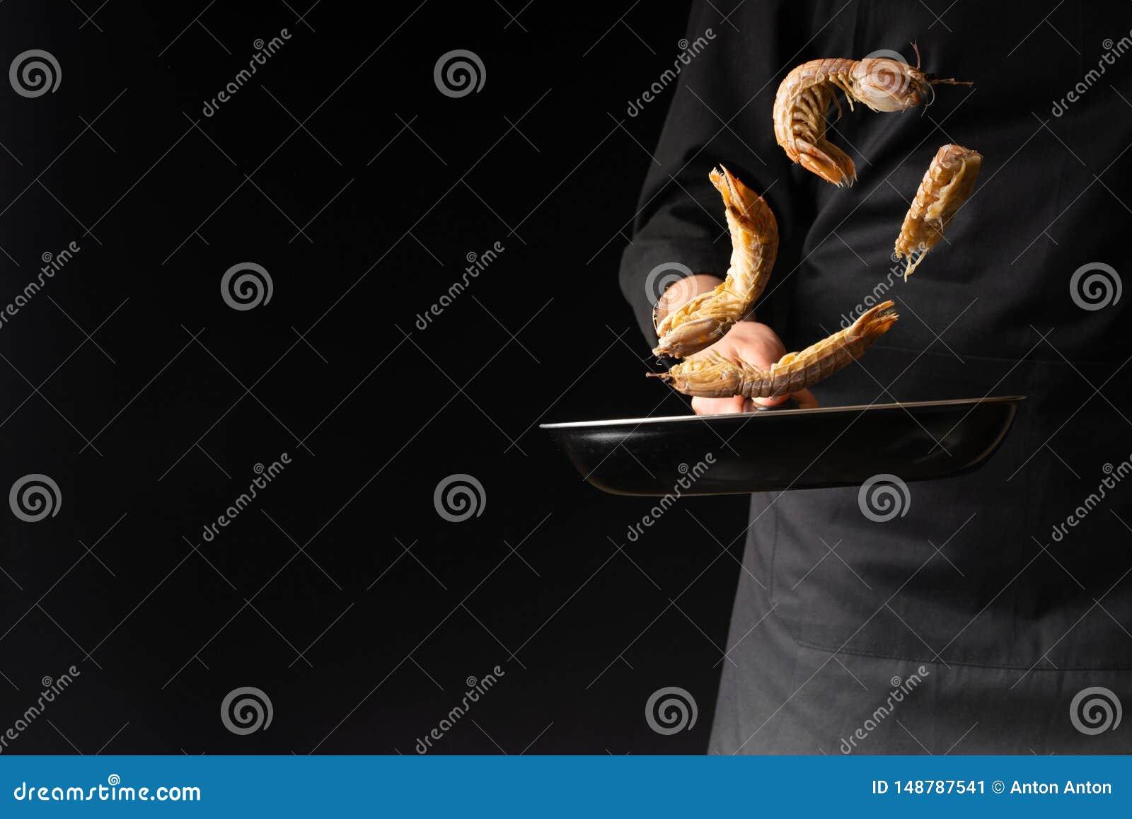 Chef preparing sea food, praying mantis shrimp, East Asian cuisine, dilikates, on a black background, horizontal photo, Thai or