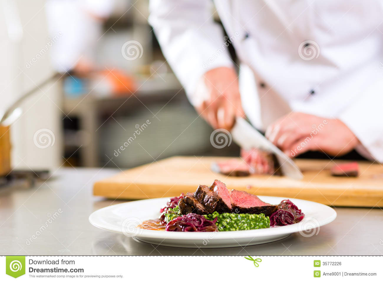 Kitchen With Food chef in restaurant kitchen preparing food stock image - image