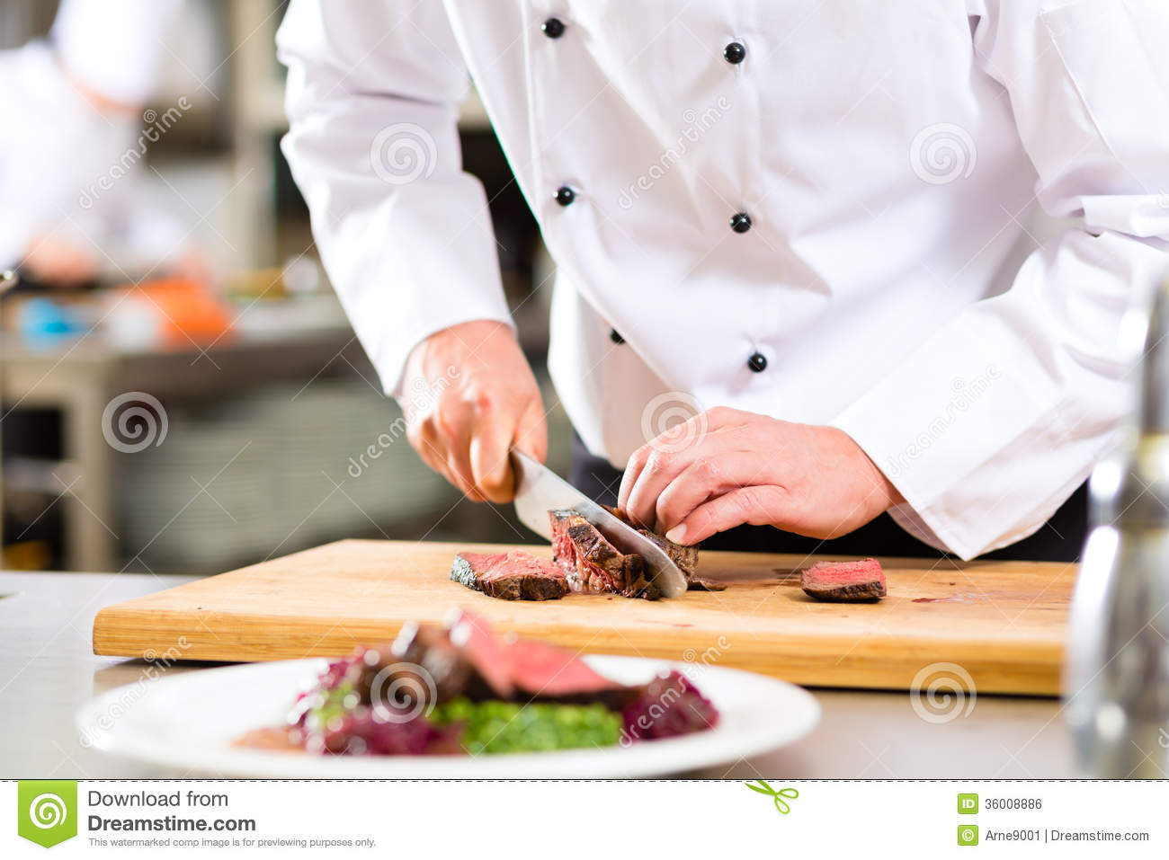 Restaurant Kitchen Hand chef in restaurant kitchen preparing food royalty free stock image