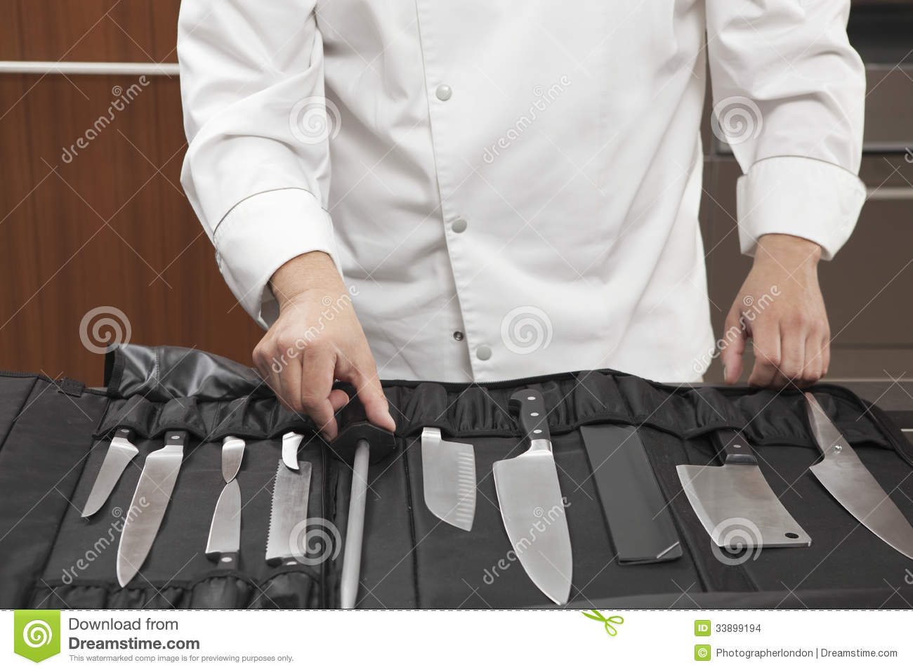 Chef Selecting Knife Sharpener Out Of Full Set Stock