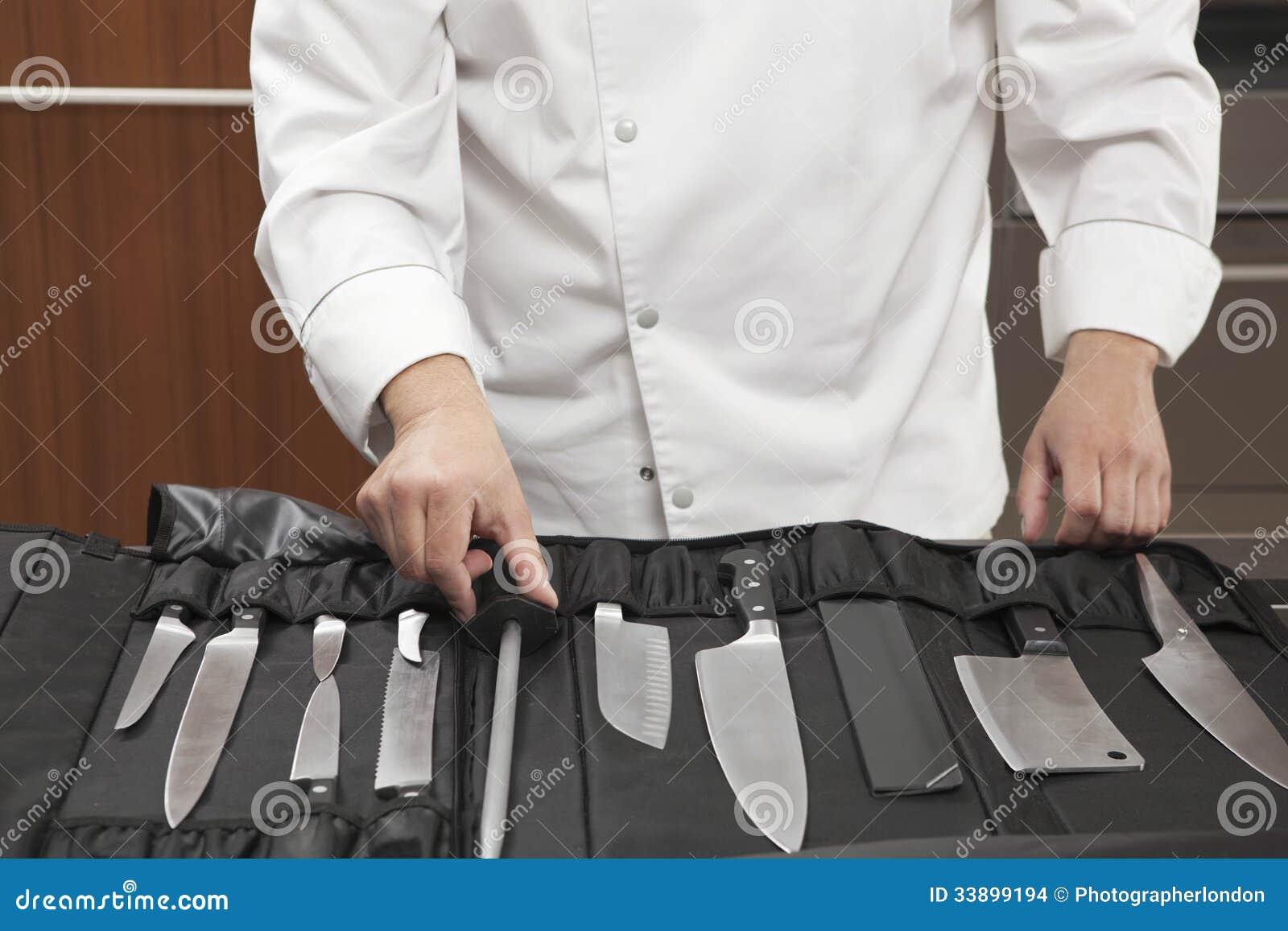 chef selecting knife sharpener out of full set stock images image 33899194. Black Bedroom Furniture Sets. Home Design Ideas