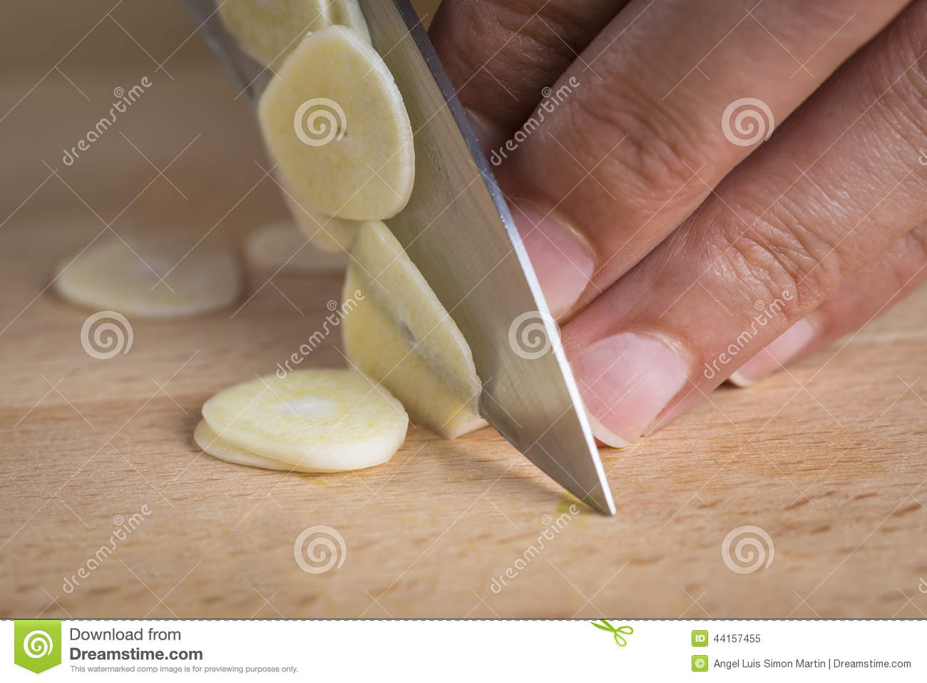 chef slicing garlic cloves stock photo image 44157455. Black Bedroom Furniture Sets. Home Design Ideas
