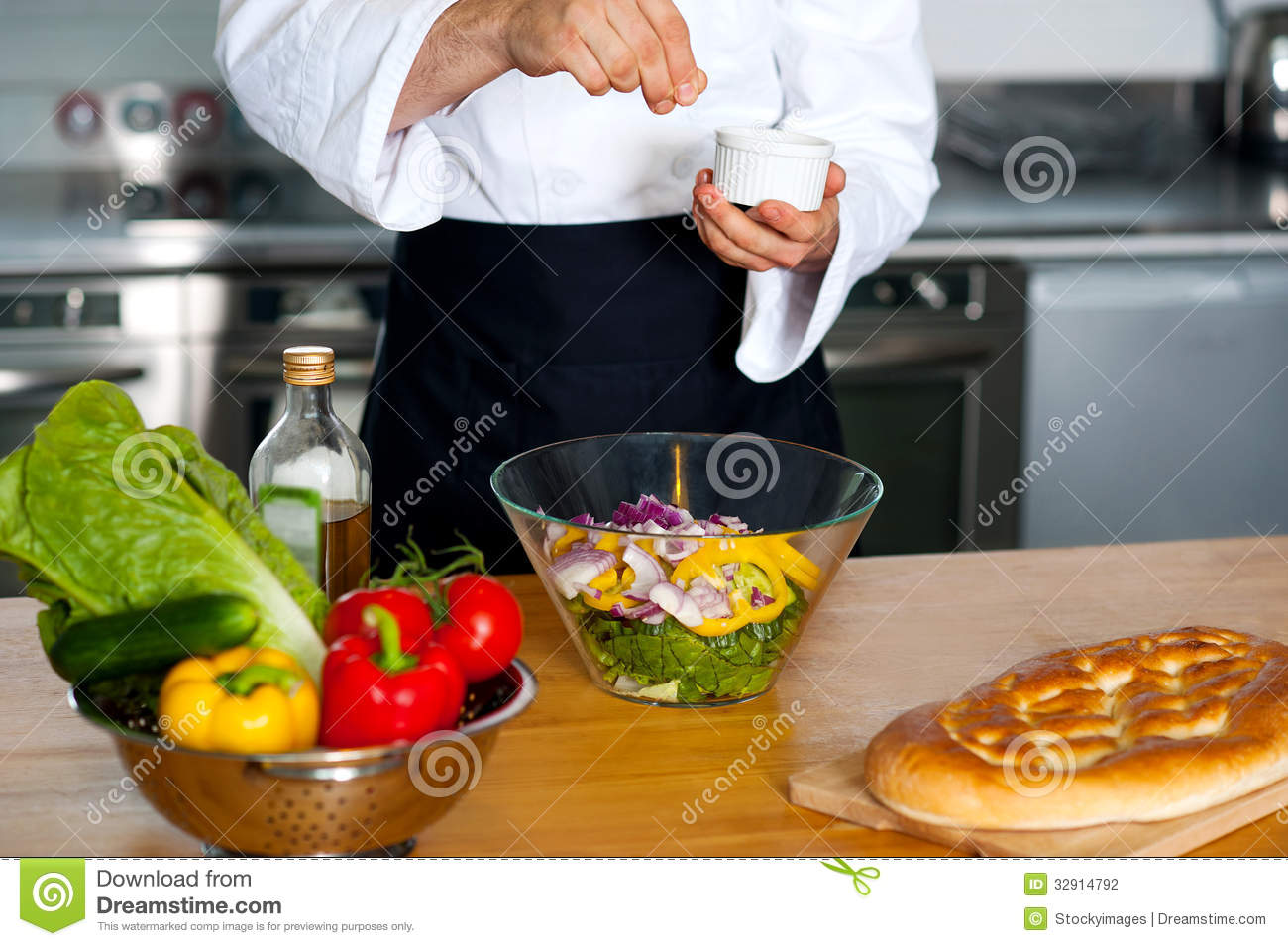 Chef sprinkling salt on vegetables stock photo image of for Fresh chef kitchen