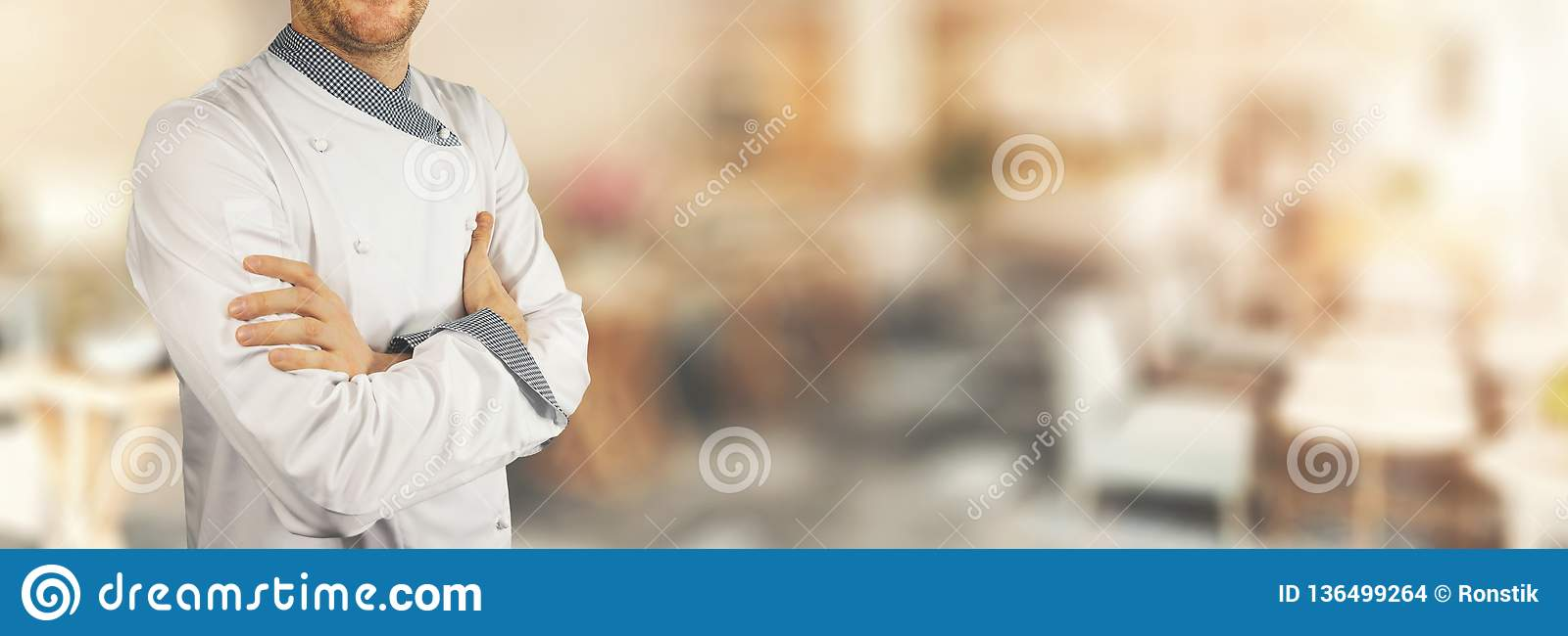Chef standing in restaurant with crossed arms. banner