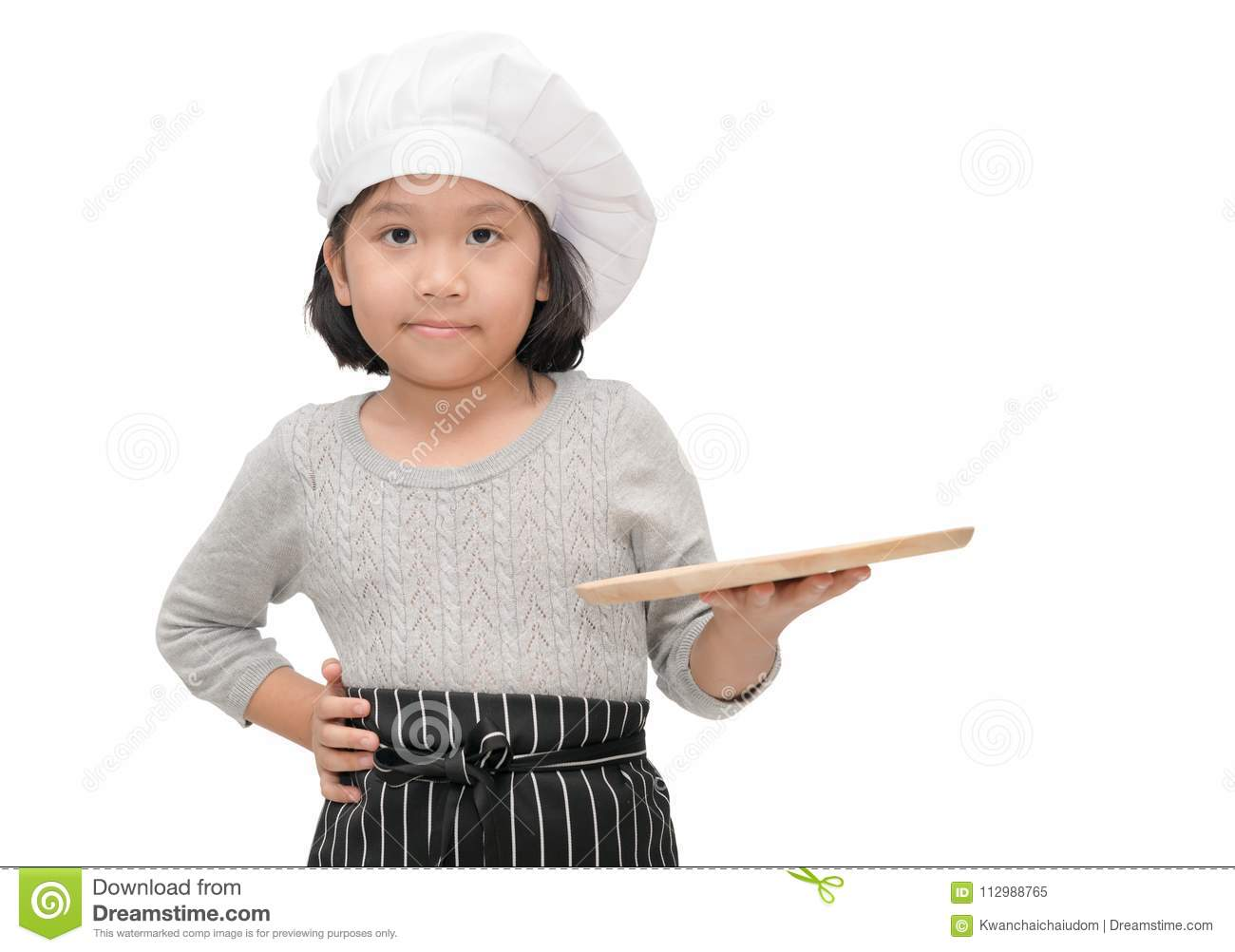 Chef in uniform cook holding blank wood dish