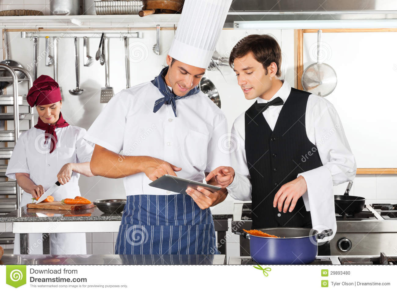 Waiter And Chef Using Digital Tablet In Kitchen Stock Photo - Image ...